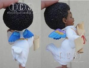 Ebony VisionsGlad Tidings Ornament