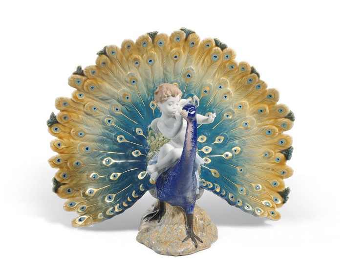 LladroCherub on a PeacockPorcelain Figurine