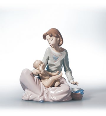 Retired Lladro Dressing The Baby