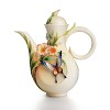 Fluttering Beauty flower and butterfly teapot