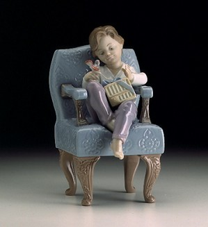 Retired Lladro-An Unexpected Gift (boy)